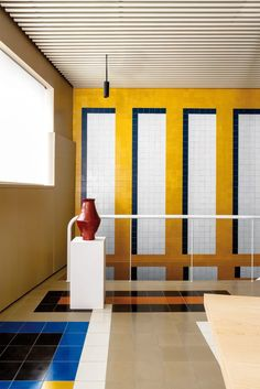 INTERIOR DESIGN: Casa Josephine and Mr. Hyde - interior design by Inigo and Rogrigo Aragon, by Huskdesignblog | interior design trends | 80s interior style | yellow wall | yellow tiles | red tiles | black tiles | beige tiles | decorative arches | orned pillars | pillars of architecture | Spanish design | Spanish architect | surrealism | surrealist interior | colorful interiors | workspace | beige walls | beige ceiling | black chairs | meeting