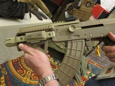 AK47 Sbr in fde (flat dark earth) with Trijicon sight and magpul afg