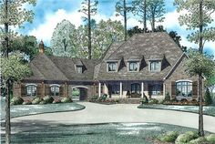 View this 1.5 story, 6 bedroom luxurious European-inspired home plan (#153-1945) and thousands of similar house designs at The Plan Collection