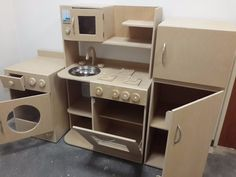 Wonderful DIY Play Kitchen from TV cabinets Cardboard Houses For Kids, Cardboard Kitchen, Cardboard Crafts Kids, Paper Folding Crafts, Wooden Play Kitchen, Cardboard Toys, Toy Kitchen, Home Decor Kitchen, Painting Kids Furniture