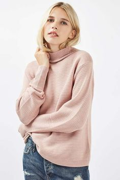 This mid weight cocoon sleeve jumper in pink is a go-to throw-on for chilly days. The slight funnel neck and wide rib detail sleeves add a modern touch.