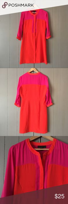 """Gorgeous Orange & Pink Colorblock Dress✨ This dress is so chic and trendy and in excellent condition. Buttons up from bottom hem to the neck. Armpit to armpit is 19"""". Length is 24"""". Hips 18"""". Offers are welcome. ☺️ Attention Dresses"""