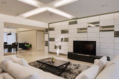 The interior of the apartment is done in white color, which serves as the perfect background for a contemporary style. The design adds contrast with black furniture pieces, and accessories, all of which makes the room less boring, and adds playfulness. In the living room,...