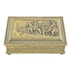 """Ornate brass footed gold gilt six inch box with a highly detailed embossed Napoleonic vignette, hinged lid and tapestry interior in gold, green and bronze."""" Light wear and patina. Antique Boxes, Gold Leaf, Vignettes, Vintage Antiques, 19th Century, Decorative Boxes, Bronze, Tapestry, Brass"""