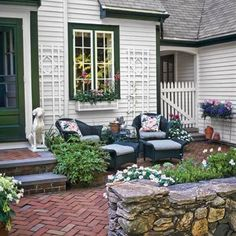 39 Budget-Wise Ways to Create Outdoor Rooms Front-Entry Courtyard Carve out a seating area in the front yard by enclosing a swath with a DIY sitting wall made from mortared fieldstone. Courtyard Landscaping, Front Courtyard, Small Backyard Landscaping, Backyard Patio, Landscaping Ideas, Mulch Landscaping, Front Entry Landscaping, Small Brick Patio, Nice Backyard