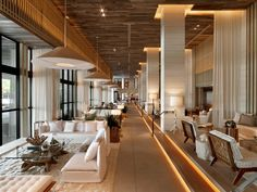A fresh and natural approach to the interiors was taken by Meyer Davis Studio. The use of lightly coloured, reclaimed timbers and a sea inspired colour scheme a change from the typically art-deco style of the Collins Ave luxury hotel strip in Miami.