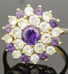 9Ct Yellow Gold Amethyst & Synthetic Diamond Cluster Ring (Size R)  https://www.jollysjewellers.com/product/9ct-yellow-gold-amethyst-synthetic-diamond-cluster-ring-size-r/