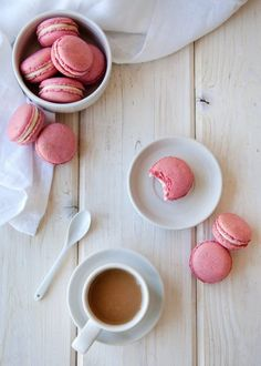 Raspberry Coconut French Macarons. Need recipes and ideas for romantic desserts for valentine's day? These almond meringue sandwich cookies are fancy and beautiful using freeze dried raspberries and almond meal.