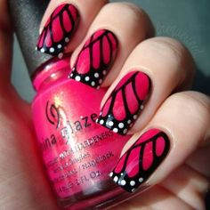 Butterfly manicure - hot pink base with stamped black butterfly wing design and white spots.