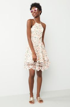 Lace, florals, and pops of color make this delightful skater dress perfect for garden parties & sun-soaked days.