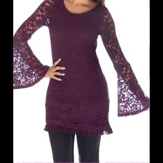"""Purple Crochet Bell Sleeve Tunic NWOT and direct from the distributer. Comes in size small only and should fit an extra small, small and small medium. Approx. 16"""" arm pit to arm pit and 31"""" in length. Scoop neck with fringe hem (see 3rd pic). Has bell sleeves and open back design. Inside is lined. Shell 67% cotton, 25% nylon, 8% spandex. Lining is 100% polyester. Smoke free home. Tops Tunics"""