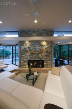 Sunken seating area and exposed stone fireplace of Palm Springs home by 	           © George Gutenberg