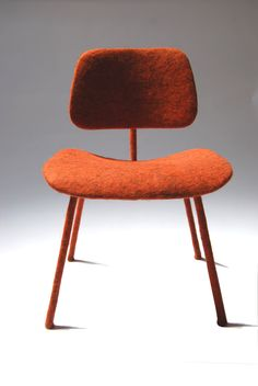 "Tanya Aguiñiga (b. 1978) is a Los Angeles-based furniture designer/maker raised in Tijuana, Mexico. Her ""Chair for Ray"" is made of blue, yellow, white, and pink felted raw wool applied to an authentic, vintage Eames Wire Chair, the DAR. The piece was a gift to LACMA from Joel and Margaret Chen. She has also created Eames DCM, made from a found DCM, which she covered in hand-felted Goatland wool. When asked to explain why she uses authentic Eames designs as the basis for her own work…"