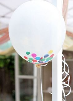 Confetti in a white or clear balloon.