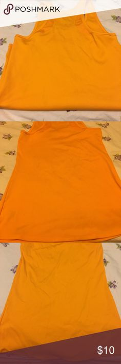 Like new Under Armour Heat Gear Tank 👟🏋🏻‍♀️ Like new, minimally worn Under Armour orange tank in Medium.   No rips tears or stains, great condition. 😺🐶pet friendly home 🚭non-smoking home 📦 ships ASAP Under Armour Tops Tank Tops