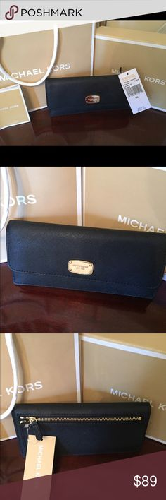 "NWT Authentic Michael Kors Jet Set Flat Wallet! Michael Kors Jet Set Slim wallet in durable Saffiano Leather. 8 card slots & 2 cash compartments with an outside zipper compartment. New with Tags! Originally sold for $108 + tax. Measurements: 7.75"" L x 3.75"" H x 1"" wide. A perfect size to fit into all of your bags. Smoke and pet free home. Michael Kors Bags Wallets"