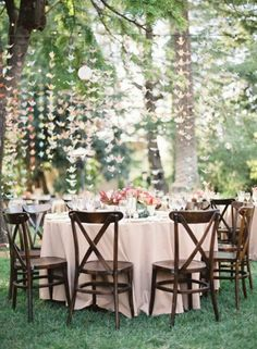 OK- so I don't love the cranes, but I do love the idea of chains (maybe flower chains) hanging in the trees. Simple, beautiful way to add a little something.  Backyard Wedding | Pinterest Most Wanted