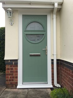 Chartwell Green composite door in a white upvc frame. Installed by Windseal Double Glazing based in Coventry & Warwickshire Front Doors, Garage Doors, Composite Front Door, Coventry, House Front, House Colors, Composition, Colour, Frame