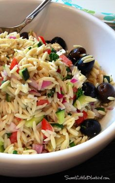 GREEK ORZO SALAD - Tried and True Recipe -  Colorful, light, refreshing pasta salad loaded with artichokes, tomatoes, black olives, cucumber, red onion, feta, fresh parsley...a great one to have in your recipe box! | SweetLittleBluebird.com