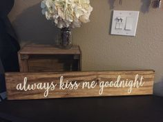 This Always Kiss Me Goodnight Sign is an elegantly painted sign that adds an element of charm to any home. Great for hanging on the wall or placing above a bed. This sign is pictured above in Golden Oak stain with Vanilla paint. The dimensions of the sign is roughly 5.5 inches high and 30 inches wide. The sign is made on reclaimed pallet wood. Each piece of pallet wood has its own unique characteristics. Therefore it could have additional knots or nail holes, or it might be a different shade…