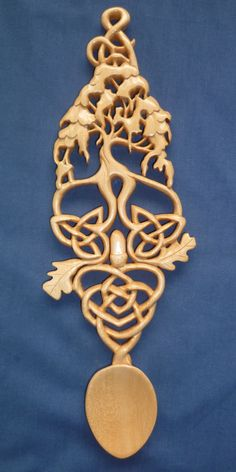 Celtic tree of life with oak leaves and knots.