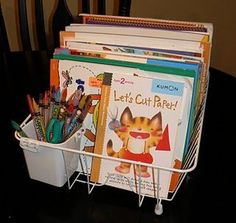 Repurposed dishrack for a coloring book/workbook organizer.  BRILLIANT!