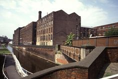 Old Mill on Rochdale Canal, Ancoats, Manchester, United Kingdom, 1992, photograph by Chris Allen.
