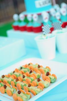 These were super easy and were a hit at the party   The Cupcake Gallery Blog: racing car party food: celery, carrot, [sultana] & hummus cars