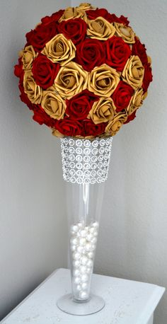 RED & GOLD Flower Ball. You will be amazed at how real and stunning the flowers look. A colored ribbon to match your wedding theme can be added if requested. These look amazing hanging from branches, hooks, chairs in your ceremony and reception, table centerpiece, for your flower girl, Bridal Shower or Engagement Party. 12 flower ball is pictured. Available in most colors to match your wedding theme. Please request a custom order for different colors. Please pick your size and ribbon c...