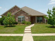 It's a great day in Wylie, TX calling this brick beaut home!
