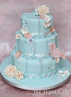 Simply beautiful sky blue cake with gorgeous flowers and sweet decoration.  Although I like the bird, I might rather have a 3-dimensional one instead of this flat look, to mimic the flowers.