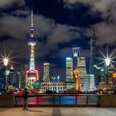 Night cityscape overlooking the Huangpu river and iconic buildings of Lujiazui Pudong including the pearl tower, jinmao tower, WFC and new Shanghai center