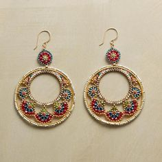 Love these! Brick stitch beaded hoops. CARNIVALE EARRINGS by Miguel Ases