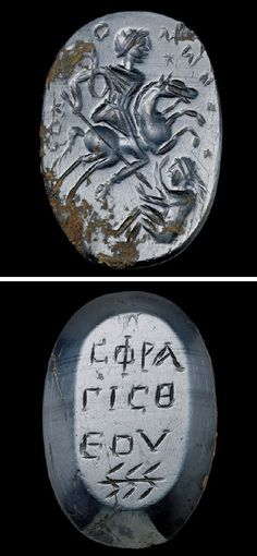 "A ROMAN HAEMATITE MAGICAL AMULET   CIRCA 4TH-5TH CENTURY A.D.   The obverse engraved with a horseman wearing a tunic, riding to the right, preparing to trample and spear a prostrate female figure, her legs bent and her arms raised to ward off the blow, a star in front of the horseman's face, a Greek inscription and dashes framing the scene, probably reading ""Solomon""; the reverse inscribed in three lines, with the sign for Chnoubis below"