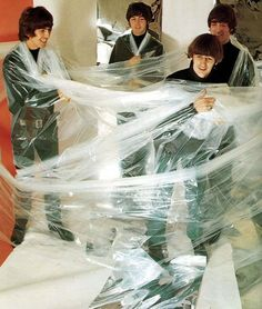 this is crazy!  reminds me of an early Coldplay photo where they're all wrapped in a blanket