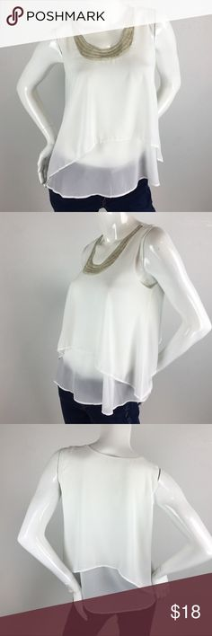 Beaded Neck Layered Blouse Sleevesless white blouse features a beaded neckline, a longer layer inside, and a shorter asymmetrical second layer outside to give it that layered look. Pair it with jeans or under one of our blazers for the office. Tops Blouses