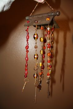 Windchime made from an antique door hinge and skeleton keys.