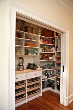 Slimline pantry including bench shelf and sliding cavity doors.