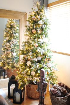 Bring in natural elements like silk flowers and some eucalyptus branches for a fresh look on your artificial Christmas tree. (#sponsored)