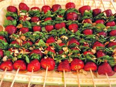 Strawberry-Spinach Salad on a Stick by lizskitchen: You can prepare the sticks ahead of time, put them in the fridge and just before serving, drizzle with the honey/balsamic dressing and sliced almonds. #Salad #Stick #Strawberry #Spinach
