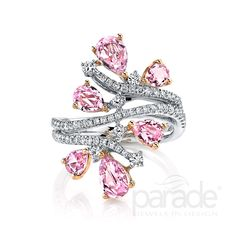 Six rose cut pink sapphires totaling 2.38 cts and 0.64 carats of white diamonds shimmer in this white and rose 18K gold ring. Diamond Info: 60-RD 0.50, 04-RD 0.14, 06-PS 2.38 CTS Fits center stone size: SIZES MAY VARY GUIDE