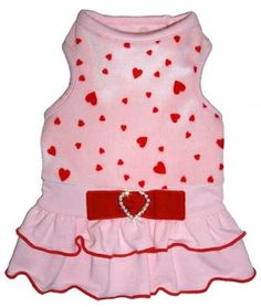 For that shining moment in the spotlight, everyone will be clamoring to wear our Starlet dress. Elegantly combining pink velour, red hearts, tiers of pink ruffles and a velvet crystal bow, it's guaranteed to turn heads. Proudly made in the U. Yorkie Clothes, Pet Clothes, Dog Clothing, Puppy Diapers, Pink Dog Collars, Cat S, Small Dog Clothes, Designer Dog Clothes, Pet Boutique