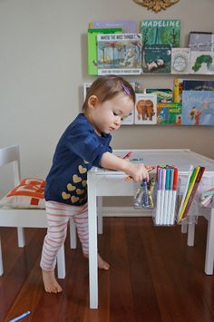 from freckles chick: Toddler art table (an Ikea LATT hack). I kinda want one adult sized!