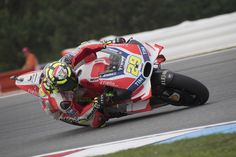 Andrea Iannone Photos - Andrea Iannone of Italy and Ducati Team rounds the bend…