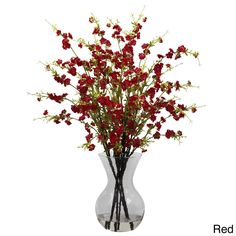 This elegant arrangement features a stunning contrast of bursting cherry blossoms and deep brown stems for a striking accent to your living space. A perfect finishing touch to any home or office, this arrangement is complete with a clear glass vase.