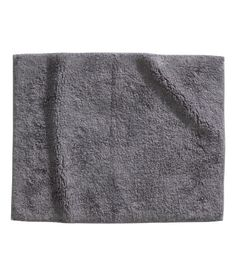 Cotton terry bath mat with anti-slip backing. aea0a0149c728