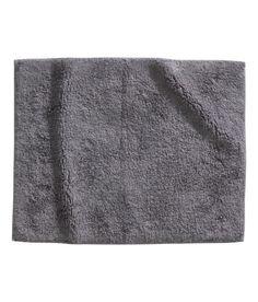 Cotton terry bath mat with anti-slip backing. 60a691b22