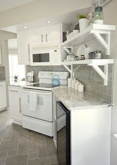 Jenna Sue Design: Stunning white and gray kitchen with white kitchen cabinets and Kashmir White Granite ...