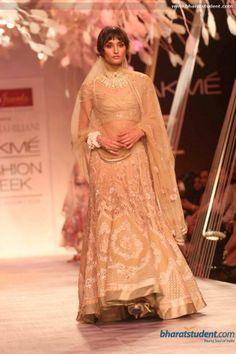 Gold lengha. Tarun Tahiliani Show at Lakme Fashion Week Summer Resort 2014