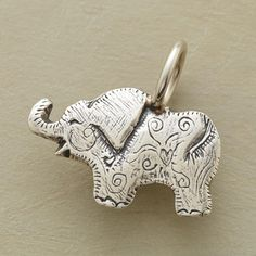 """STERLING SILVER ELEPHANT CHARM--An elephant bears good luck wishes. Sterling silver. By Jes MaHarry. 7/8"""" to 3/4""""L."""
